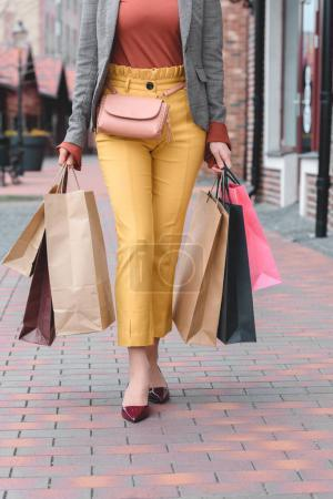 Photo for Cropped image of woman carrying shopping bags - Royalty Free Image