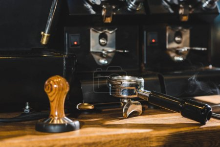 close-up view of modern coffee machine on wooden table in coffee shop