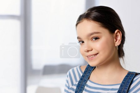 portrait of adorable preteen child looking at camera at home