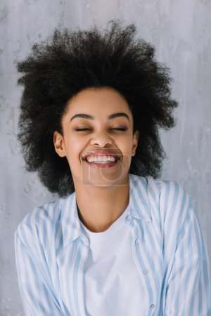 Photo for Happy smiling african american girl on grey wall background - Royalty Free Image
