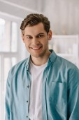 Smiling man wearing lounge wear clothes at home