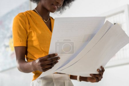 Photo for Cropped shot of beautiful african american freelancer with papers in hands at home office - Royalty Free Image