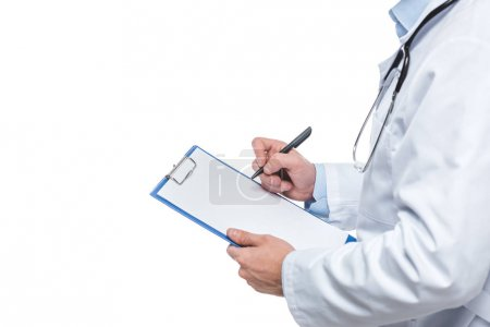 Photo for Cropped image of male doctor writing diagnosis in clipboard isolated on white background - Royalty Free Image