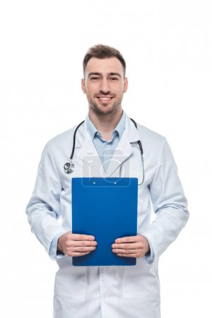 smiling male doctor with stethoscope and clipboard isolated on white background