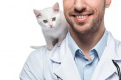 cropped image of smiling veterinarian with kitten isolated on white background