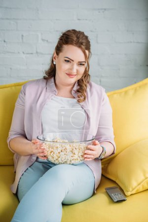 Photo for Beautiful woman watching movie with popcorn at home - Royalty Free Image