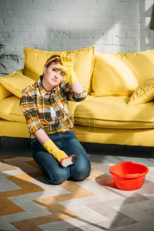 beautiful woman tired after cleaning carpet at home
