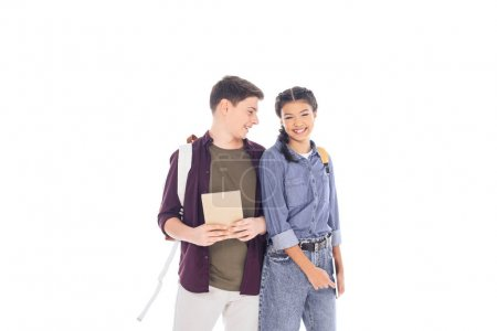 portrait of smiling students with backpacks isolated on white