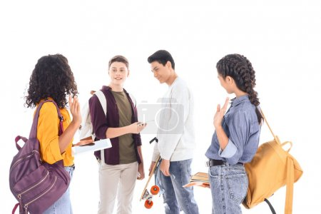 multiracial students with backpacks, digital devices and notebooks isolated on white