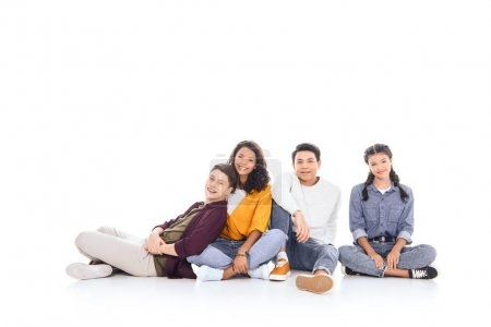 smiling interracial teenagers looking at camera isolated on white