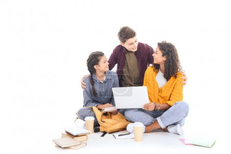 multicultural teenagers with laptop together isolated on white