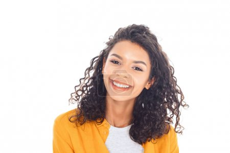 portrait of smiling african american teenager with curly hair isolated on white
