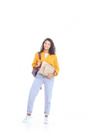 smiling african american student with backpack and books isolated on white