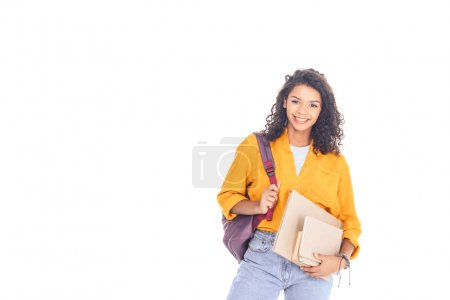 portrait of smiling african american student with backpack and books isolated on white
