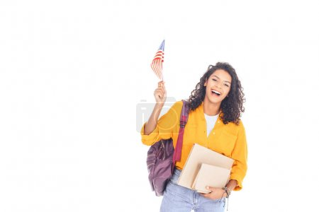 portrait of happy african american student with american flag, backpack and books isolated on white