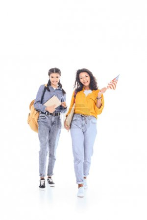 interracial students with backpacks, books and american flag isolated on white