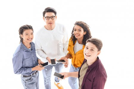 high angle view of multicultural teen friends with smartphones isolated on white