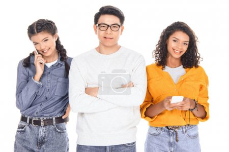 portrait of interracial teenagers with smartphones isolated on white