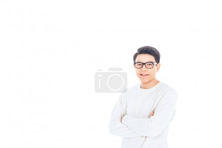 portrait of asian teenager in eyeglasses with arms crossed isolated on white