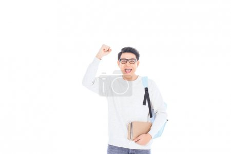 portrait of happy asian student with notebooks isolated on white