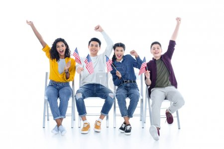 group of teen students with usa flags sitting on chairs isolated on white