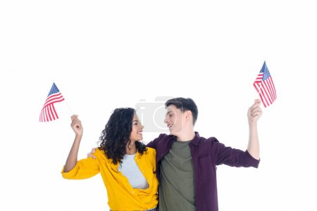embracing teenage students with american flags isolated on white