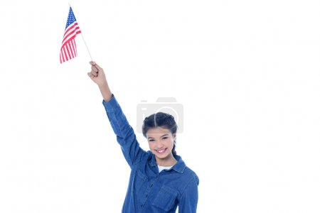 happy teenage student girl with usa flag in raised hand isolated on white