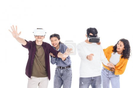 Photo for Group of happy students playing with vr headsets isolated on white - Royalty Free Image
