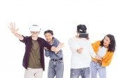 group of happy students playing with vr headsets isolated on white