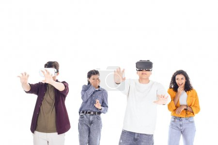 group of multiethnic students playing with vr headsets isolated on white