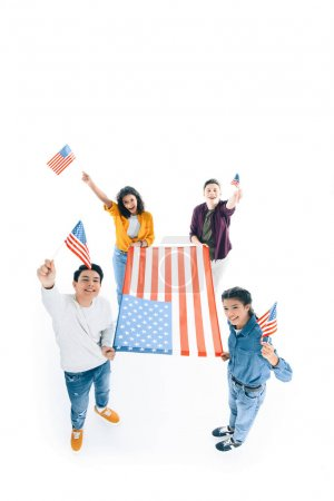 high angle view of group of multiethnic teens with usa flags isolated on white