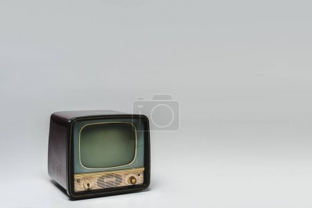 retro tv with blank screen on grey surface