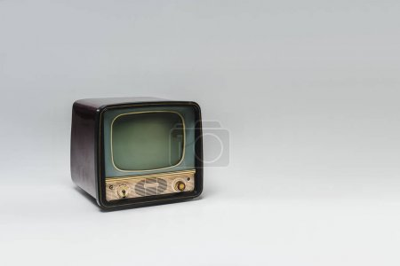 vintage tv with blank screen on grey surface