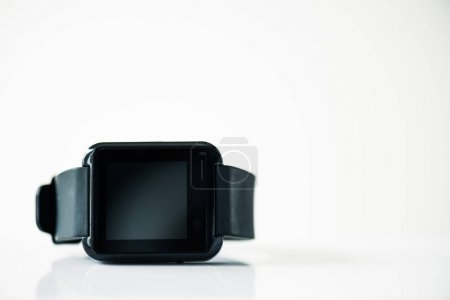 Photo for Close-up view of smartwatch with black screen on grey - Royalty Free Image