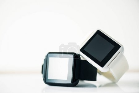 close-up view of smartwatches with blank screens on grey
