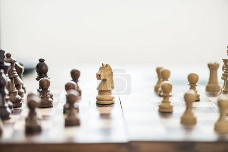 close-up view of wooden chess figures on chess board, selective focus