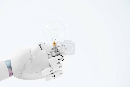 close-up view of hand of robot holding light bulb isolated on white