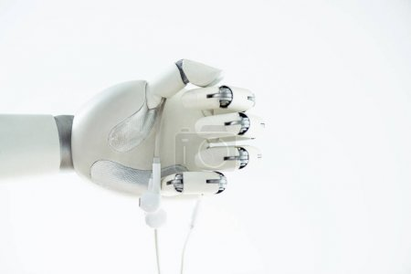 close-up view of robotic hand holding earphones isolated on white
