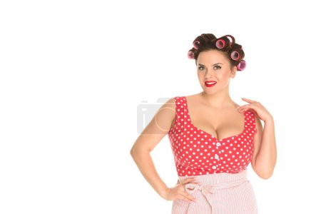 attractive plus size housewife in red dress with curlers in hair isolated on white