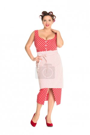 beautiful plus size housewife in red dress with curlers in hair isolated on white