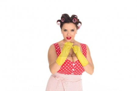angry plus size housewife in rubber gloves standing in fight pose isolated on white