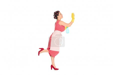 attractive plus size woman in rubber gloves with cleaning supplies wiping blank space isolated on white