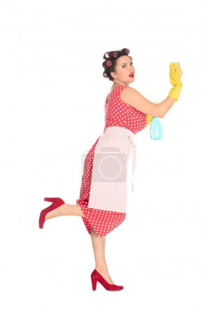 emotional plus size woman in rubber gloves with cleaning supplies wiping blank space isolated on white