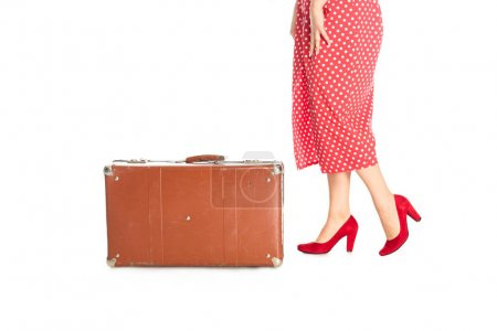cropped shot of woman with retro suitcase isolated on white
