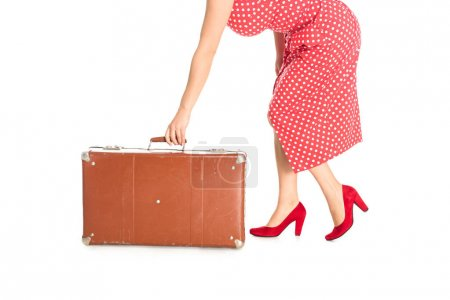 cropped shot of woman holding vintage suitcase isolated on white