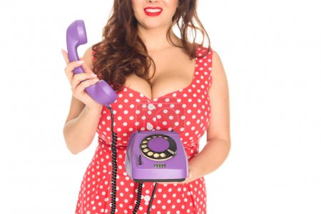 cropped shot of plus size woman with vintage rotary phone isolated on white