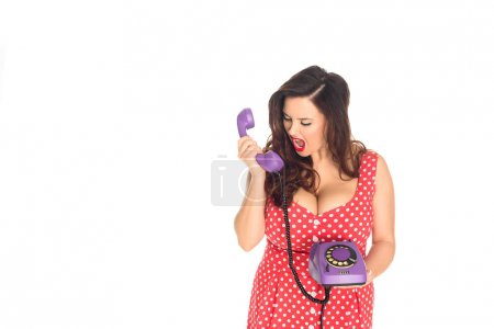angry plus size woman shouting at vintage rotary phone isolated on white