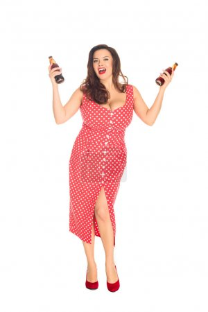 happy plus size woman with bottles of soda looking at camera isolated on white