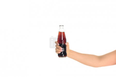 cropped shot of woman holding bottle of soda isolated on white