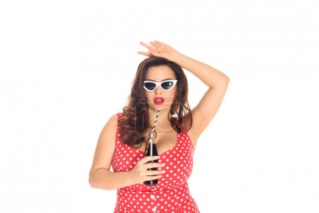 attractive plus size woman in dress and vintage sunglasses with bottle of soda isolated on white